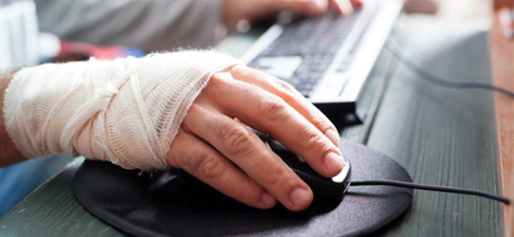bandaged hand using computer